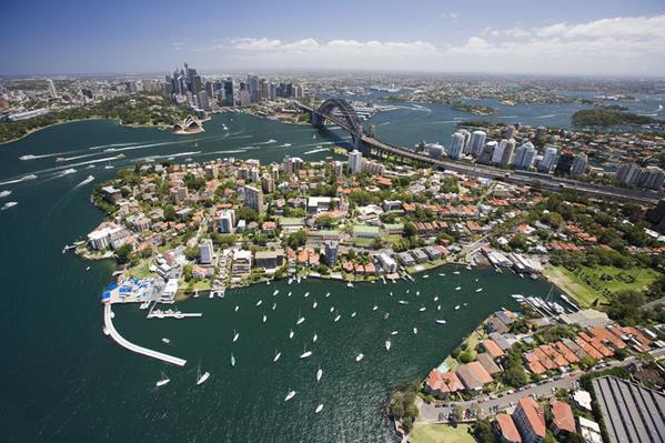 Aerial of Sydney Harbour: a great place to visit in New South Wales.  Image © Hamilton Lund; Destination NSW. This photo sponsored by Solar Energy Consultants Category.